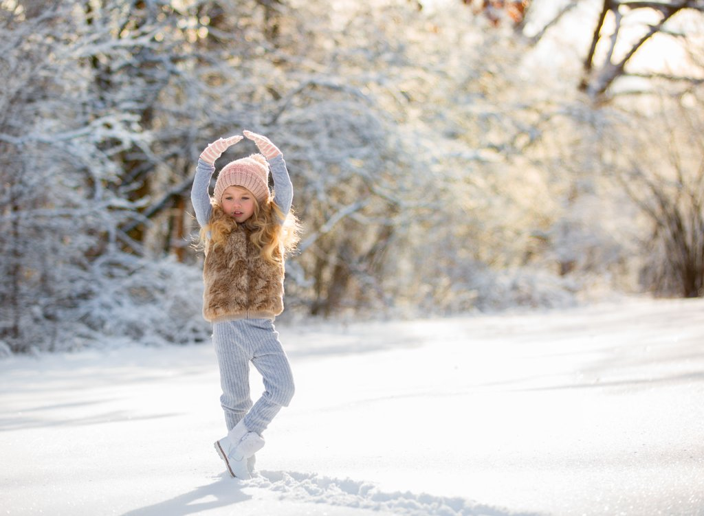children-photography-chicago-suburbs-girl-dansing-snow