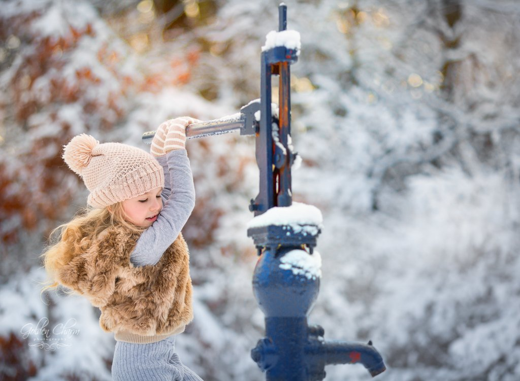 children-photography-chicago-suburbs-girl-priming-pump-snow